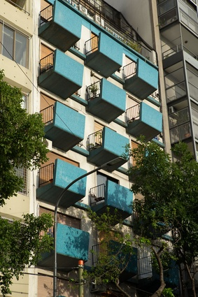 Blue mosaic tiles front the balconies of this Buenos Aires apartment building.