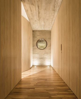 The interior palette is made up of wood and shuttered concrete.