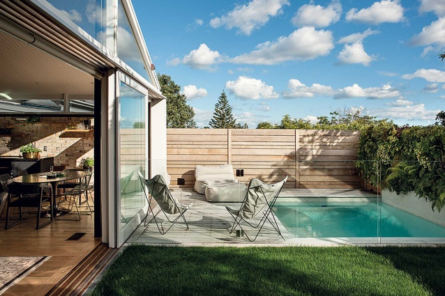 A pocket lawn and small pool make up the back of the section.
