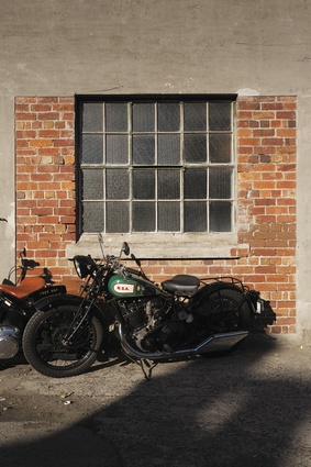 Building exterior with classic BSA motorcycle.