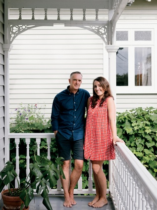Charles Walker and Jessica Barter in front of their villa.