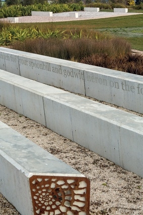 Concrete seating with perforated metal screens at ends. The bleachers are inscribed with a purpose-written poem by Cliff Fell.