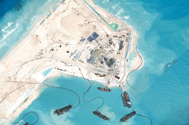 Chinese dredgers have created a land mass that spans the entire existing Fiery Cross Reef. An airstrip is currently under construction.