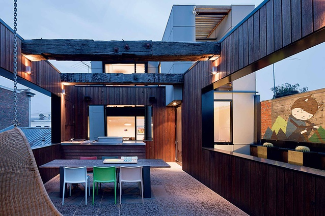 The exterior spaces feature timber-clad walls, reflecting the owners' fondness for raw materials.