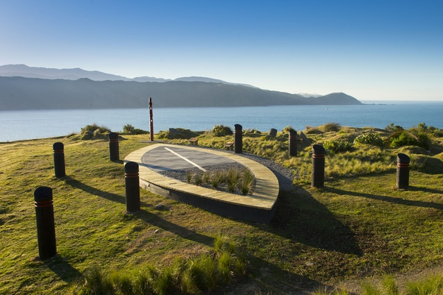 The mythical waka overlooks the Wellington heads, with the pouwhenua aligned to the distant Orongorongo Mountains.