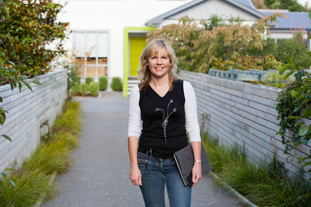 Architect Katherine Skipper in front of the Lochiel Road House, Khandallah, Wellington.
