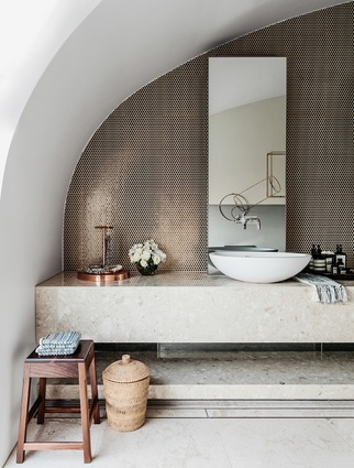 This Pacific Lighthouse penthouse bathroom not only captures the laid-back breeziness of its beachside location but also references the wealth and glamour of many of its inhabitants through luxe details and accents.