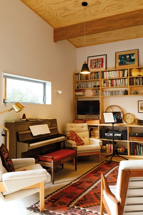 The living area doubles up as a music room for its owners who are talented musicians.