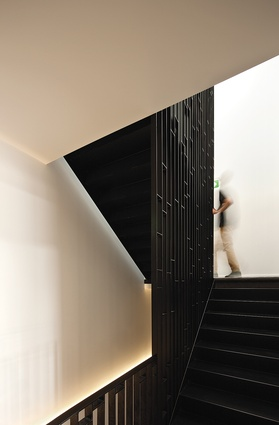 A dramatic steel screen on the shared stairs to the apartments.