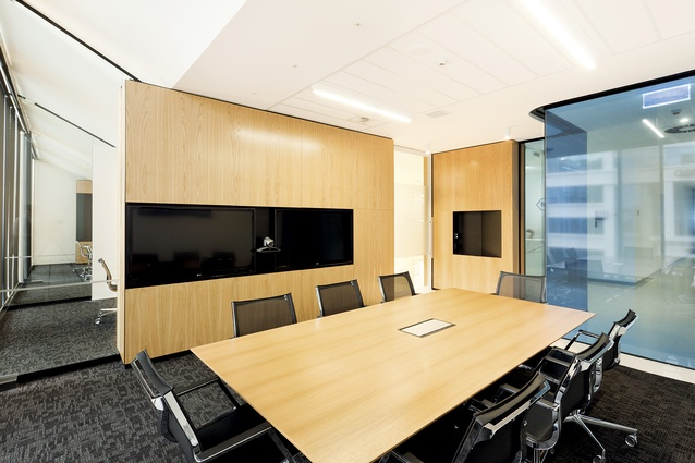 Lower level meeting rooms and boardroom, finished in oak, can be visually segregated by a ceiling-to-floor, rich-black curtain.