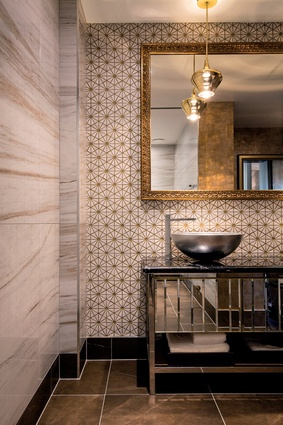 The ensuites in each of the four luxury suites are different. Tiles and mirror frames with traditional patterning offer a twist when paired with the slickness of metallics.