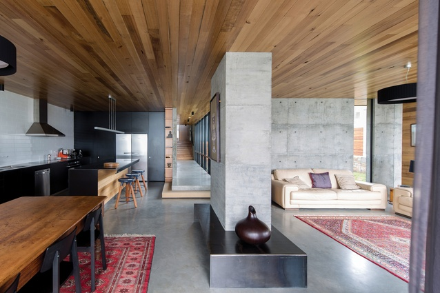 The planning and spatial sequence are precisely ordered to optimize space, belying the modest size of the house.