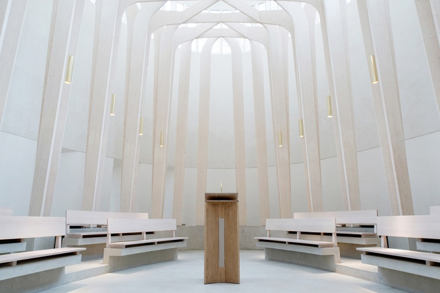 Bishop Edward King Chapel, UK, 2013. Slender timber columns create a dream-like sensation of being in a forest of tall trees, with the branches forming a latticed canopy overhead.