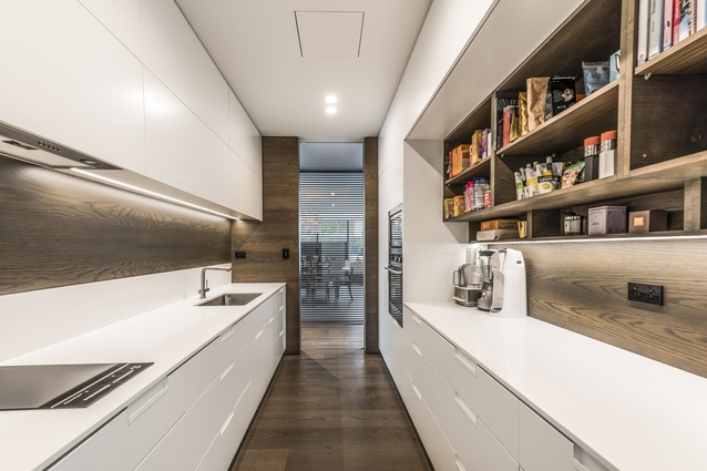 The kitchen has a working scullery hidden behind the more public kitchen front, which is open the living area.