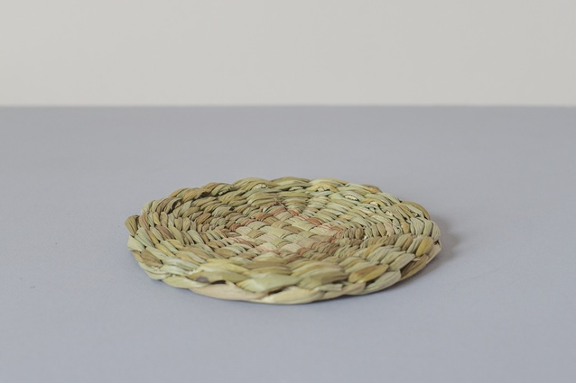 "Circular rush table mat | <a href=""http://www.everyday-needs.com/products/circular-rush-table-mat-large"" target=""_blank""><u> $53 from Everyday Needs.</u></a>"