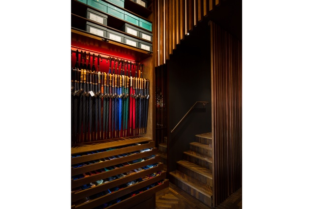 Custom-built timber cabinetry lines the walls of the store.