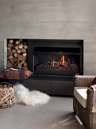 This concrete backed fireplace creates a cosy outdoor room.
