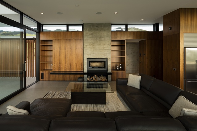 Matheson House, Nelson. The-open plan living area features warm walnut panelling.