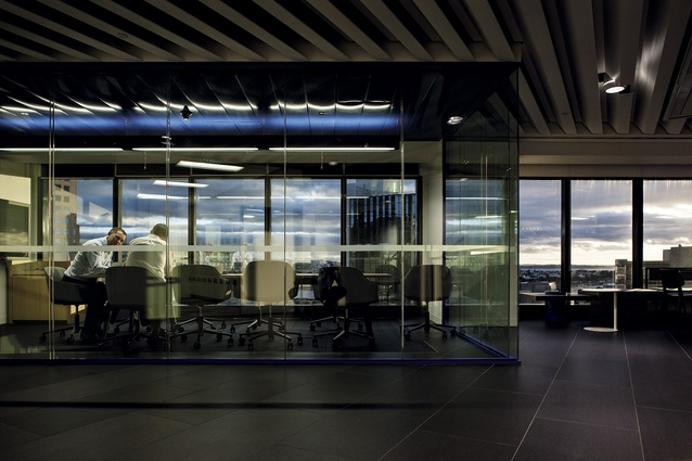 One of the hub area variations, this time a glass-enclosed meeting room with subtle blue details acknowledging the bank's brand colour. The bespoke 'z' fin ceiling form, is an angular extrusion that plays  on the base building's geometries.