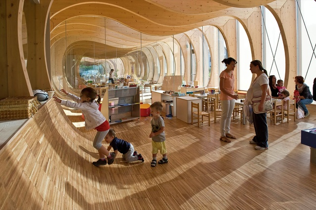 The Guastalla Kindergarten in Italy is made from natural timber. Areas of connection are designed to be used with curiosity, encouraging creativity and growth.
