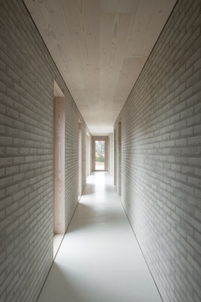 Pale white bricks complement whitewashed timber ceilings and white concrete floors.