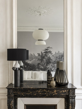 The ceiling light reflected in the mirror is by Jaime Hayon.