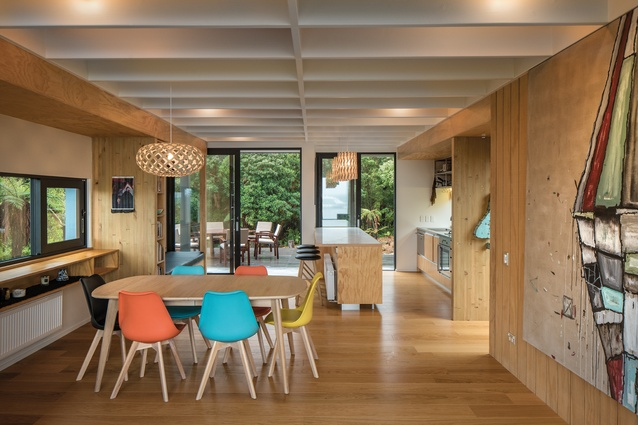 The kitchen, dining and living area forms a long tube of space with views over the boats, with a secluded side deck.