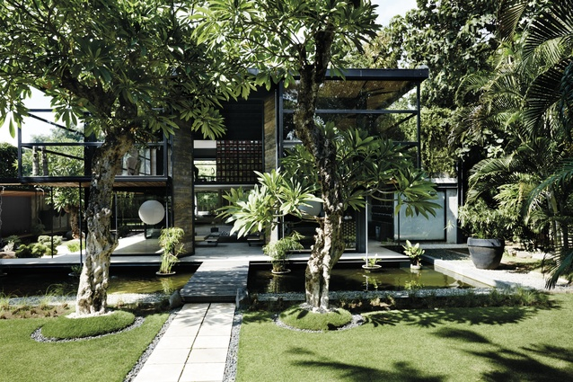 The scale and proportions of the villa set amongst a manicured Zen garden make a strong first impression.