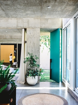 """Using concrete could have been """"heavy,"""" but the playful shapes, large openings and clever use of natural light create a structure that is anything but oppressive."""