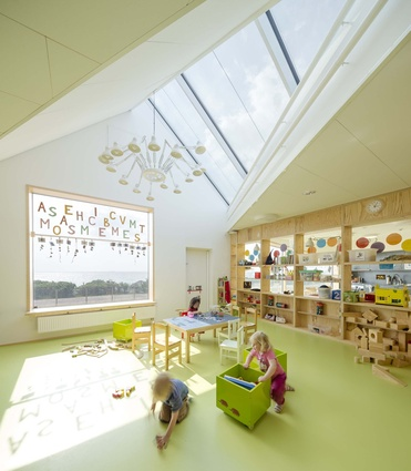 Råå Day Care Center. Large windows in the facade and the roof create a connection with the sea, and allow for plenty of natural daylight into all the playrooms.