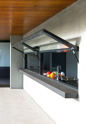 Awning-style windows in the kitchen open it up to the entry deck, making meal set-up easy.
