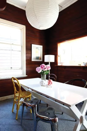 Bright spots of colour as in the yellow bentwood chair relieve the dining space from feeling too dark or old fashioned.