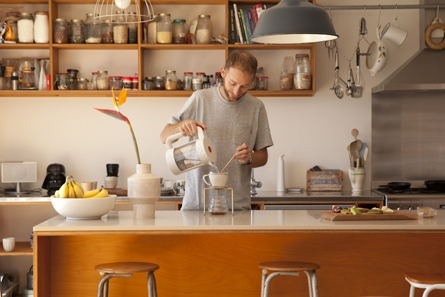 Steve Ferguson making coffee with one of their favourite objects, a gold hand grinder.