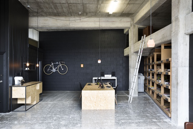 Red Architecture's new premises is a converted warehouse. Original storage racks have been retained.