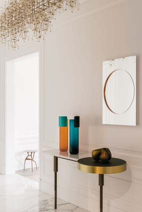 A Pierre Charpin mirror in the entry echoes the circular form in the Doshi Levien console.