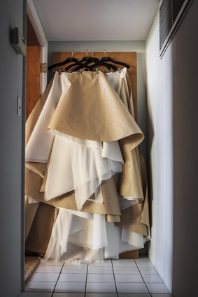 """The atelier door. """"I often use this door to hang long gowns that are in process. Right now, it has 37 metres of silk organza and silk chiffon."""""""