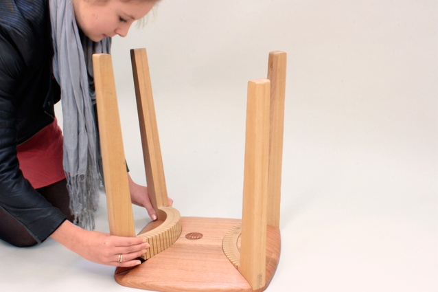 The stool uses precision-cut timber to retaining pressure, with no need for fastenings.