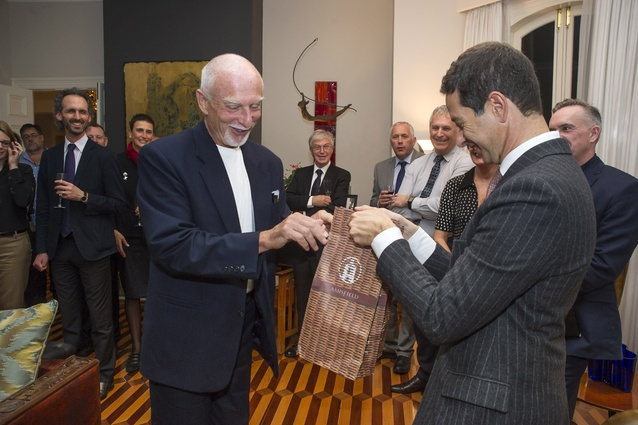 Tony van Raat presents a bottle of Amisfield wine to His Excellency Carmelo Barbarello – Ambassador of Italy.