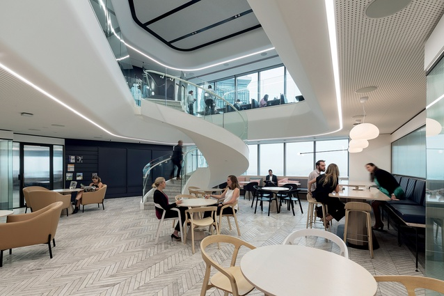 The sweeping, futuristic staircase creates a big 'moment' in the social hub space of Warren and Mahoney's reinvention of the Russell McVeagh law firm.