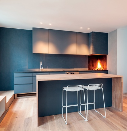 The kitchen boasts an open fireplace.