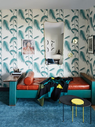 Sitting room. Wallpaper is Palm by Cole and Son; carpet by Stepevi Bed: Jean Prouvé 1950; coffee table is by Kangourou from Mathieu Matégot; mirror is by Gio Ponti; artwork is by Paul Kowan.