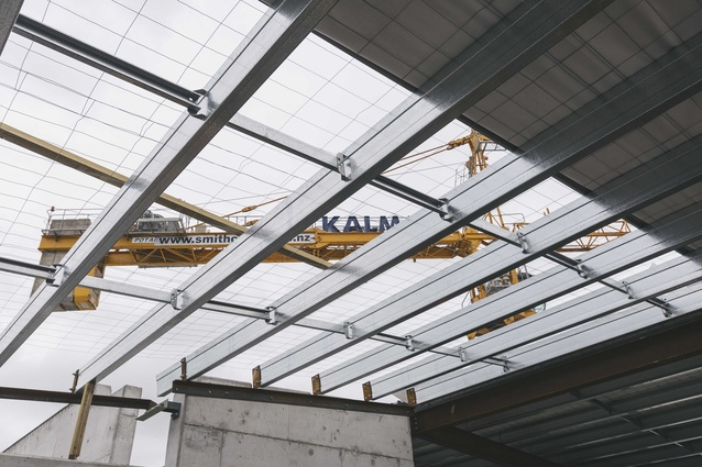 Once the roof was completed, materials were lifted to upper levels with the use of crane platforms on the side of the building.
