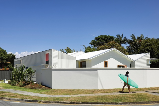 The two new pavilions, one each to the north and south of the site, mirror the existing home's gabled roof form.