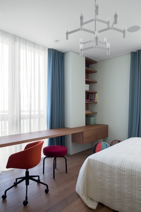 A Hay AAC52 chair and Cassina LC8 stool at the desk in one of the children's rooms.