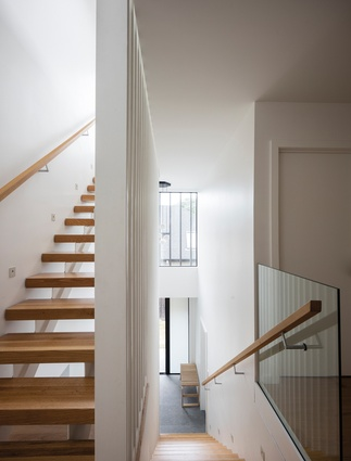 St Heliers House. The stairwell covers three stories and features vertical screening.