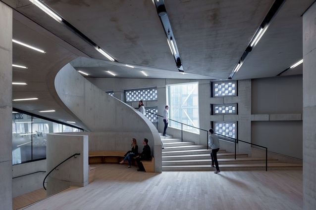 A spiralling concrete staircase ascends from The Tanks to meet the entrance and shop.