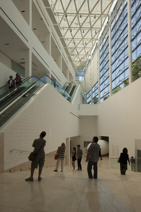 Gallery visitors looking at a wall mural by Eduardo in Buenos Aires' leading contemporary art gallery MALBA.
