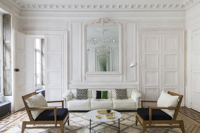 The two French 1930s armchairs were purchased at the flea market. The TS coffee table is designed by Gam Fratesi for Gubi. The polished brass dishes are by Tina Frey.