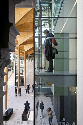 Extensive glazing gives a distinct transparency to the addition which contrasts with the existing buildings.