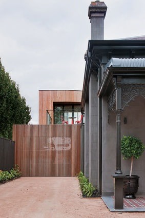 The timber clad contemporary L-shaped addition.